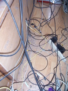 Wiring mess behind desk, showing wall warts
