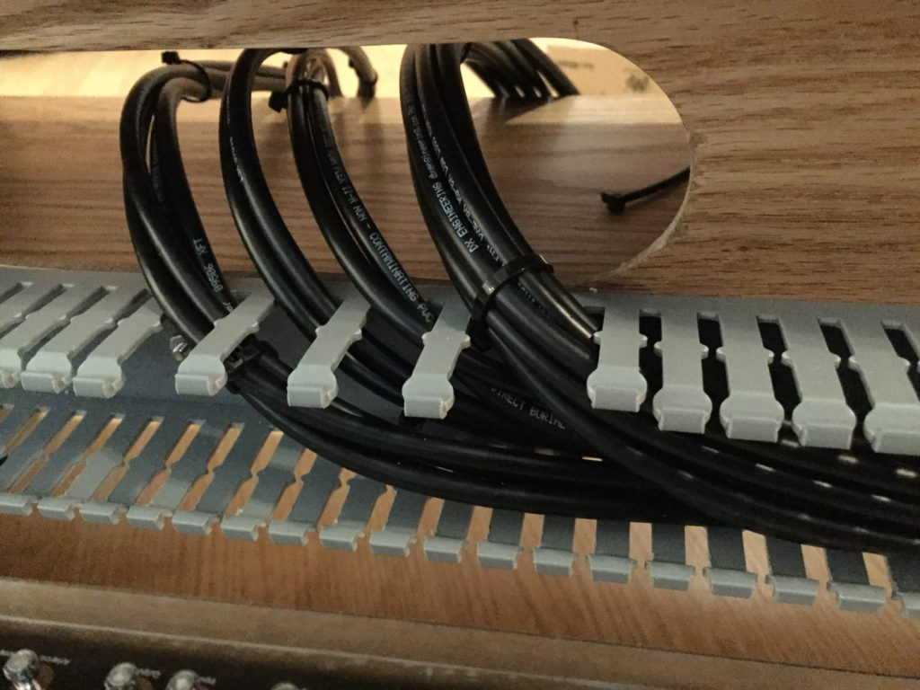 Detail of patch panel cable feed.